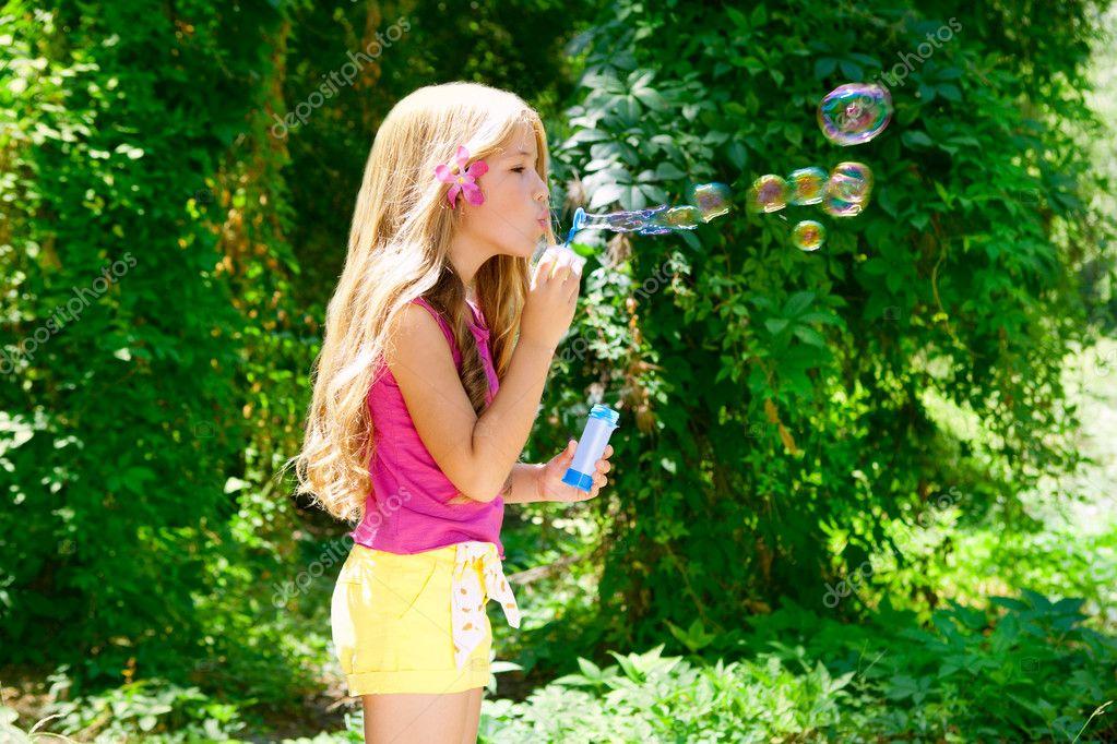 Kid Blowing Soap Bubbles Children Blowing Soap Bubbles