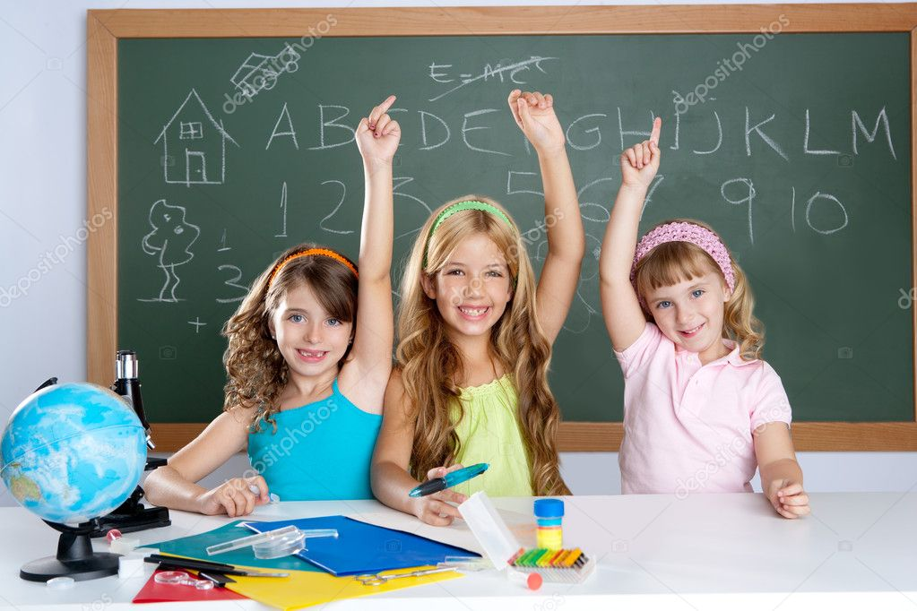 Clever kids student group at school classroom raising hand as smart children — Stock Photo #6219386