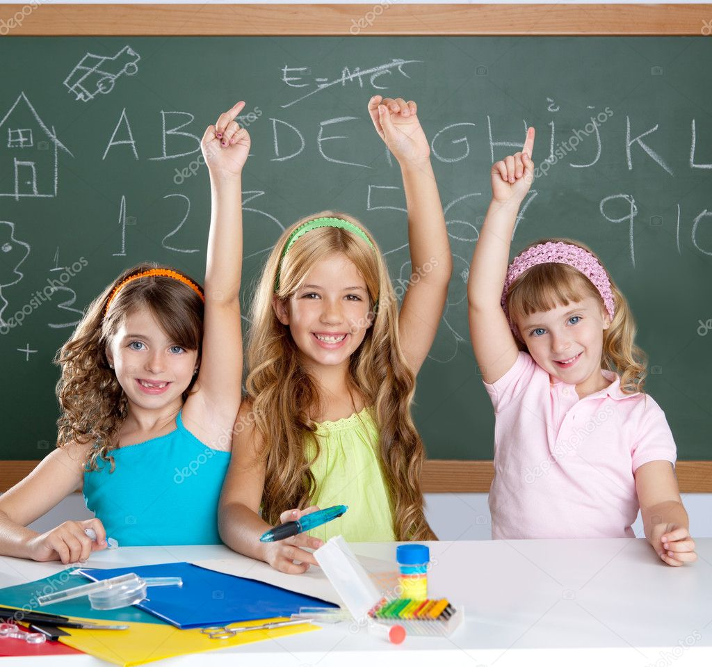 Clever kids student group at school classroom raising hand as smart children — Stock Photo #6219461