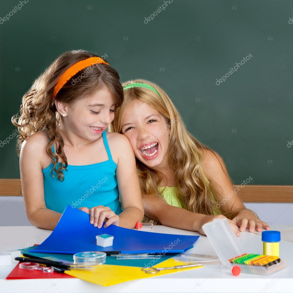 Happy laughing kids student girls at school classroom in desk — Stock Photo #6219649