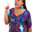 Beautiful African American woman showing something — Stock Photo