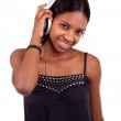 Young black woman listening to music — Stock Photo