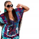 Portrait of beautiful young black woman dancing — Stock Photo