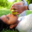 Stock Photo: Beautiful black woman eating an apple