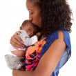 African American mother kissing her baby boy - Stock Photo