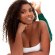 Portrait of a young beautiful african american girl lied — Stock Photo