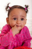 Beautiful african american baby girl with his finger in the mouth — Stock Photo