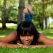Young black woman lying down on the grass — Stock Photo #6425003
