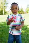 Cute Little african american baby boy playing — Stock Photo