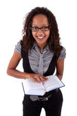 African american woman holding a book — Stock Photo
