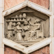 Vintage bas-relief in Florence, Italy - Stock Photo