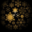 Golden snowflakes on black background — Stock Vector