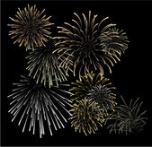 Set of silver and golden fireworks — Vector de stock