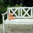 Stock Photo: Toy on wooden bench of park