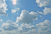 Day cloudy sky with sun — Stock Photo