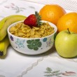 Bowl of cereals with fruit — Stock Photo