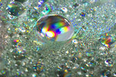 Shiny colorful drops of water — Stock Photo