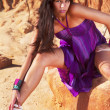 Beautiful young girl with purple dress — Stock Photo #6555591
