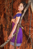 Beautiful young girl with purple dress — Stock Photo