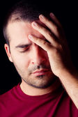 Male man with a headache — Stock Photo