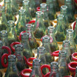 Stock Photo: Row of empty glass bottles