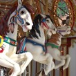 Three carousel horses — Stock Photo