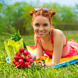 Stock Photo: Beautiful happy womwith colourful vegetables