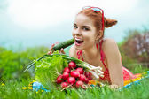 Beautiful happy woman with colourful vegetables — Stock Photo