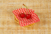 The small basket with two cherry — Stock Photo