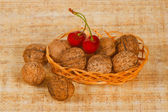 The small basket with cherry and nuts — Stock Photo