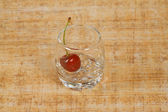 The glass of and red cherry — Stock Photo