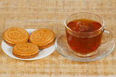 The cup of morning tea and three cookies — ストック写真