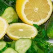 Fresh lemon, cucumbers and greens — Stock Photo #5937182