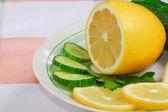 The fresh lemon, cucumbers and parsley — ストック写真