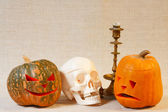 The cheerful and sad halloween pumpkin and skull — Stock Photo