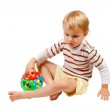 Little boy playing with colorful toy — Stock Photo #6641479