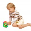 Little boy playing with colorful toy — Stock Photo