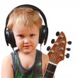 Stock Photo: Little boy with headphones and guitar
