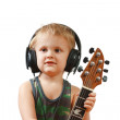Little boy with headphones and guitar — Stock Photo