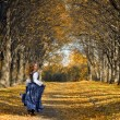 Girl dressed in a retro-style run on the autumn alley — Stock Photo #5399345
