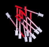 Many insulin syringes on black — Stock Photo