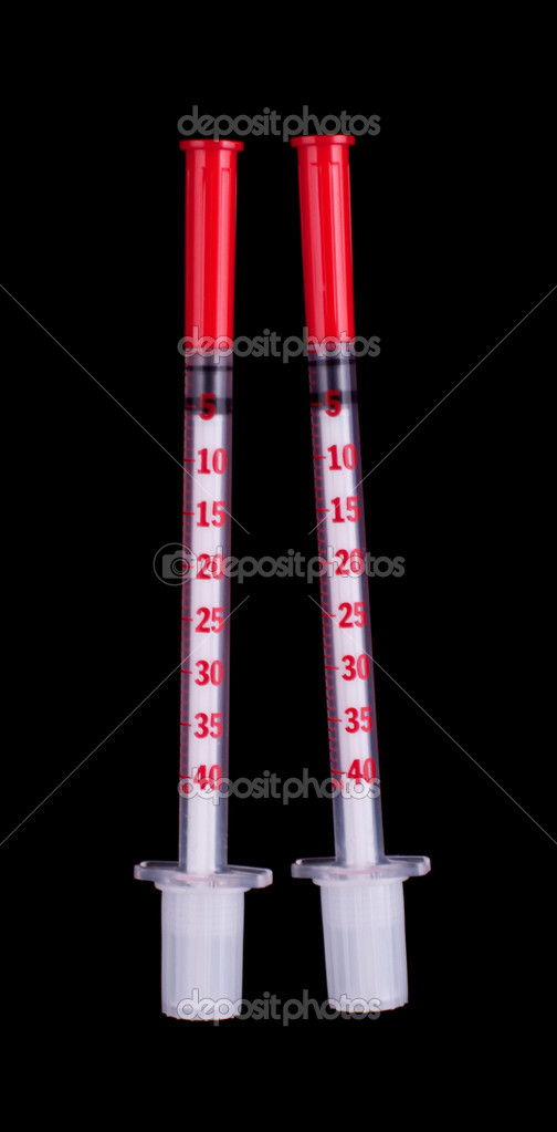 Two insulin syringe isolated on a black background — Stock Photo #5482637