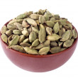 Cardamon seeds in a ceramic bowl — Stock Photo