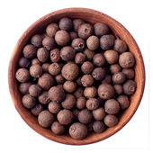 Allspice in a wooden bowl — Stock Photo