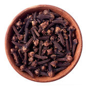 Cloves in a wooden bowl — Stock Photo