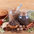 Still life of different spices on wood - Stock Photo