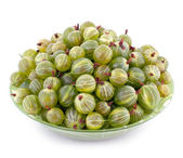 Bowl full of gooseberry isolated on white — Stock Photo
