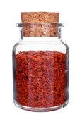 Bottiglia di vetro piena di peperoncino, isolato su bianco — Foto Stock