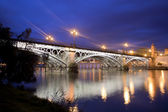 Sevillie, panorama of the old Triana Bridge. — Stock Photo