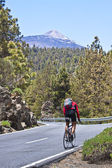 Man cycling towards the Teide volcano. — Stock Photo